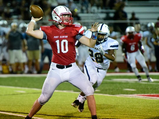 Port Clinton's Joey Brenner throws a pass against Norwalk.