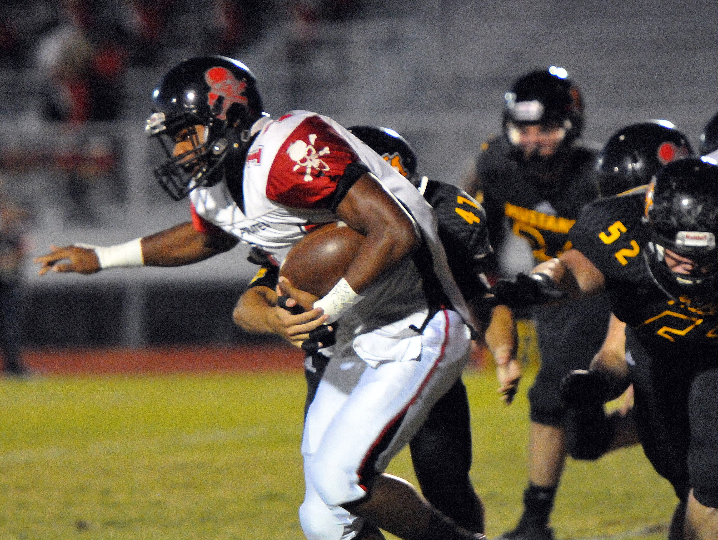 Palm Bay High's #14 Brian Lankford-Johnson picks up some nice yards past a host of Merritt Island defenders during Friday nights game held at Merritt Island High's Mustang stadium.