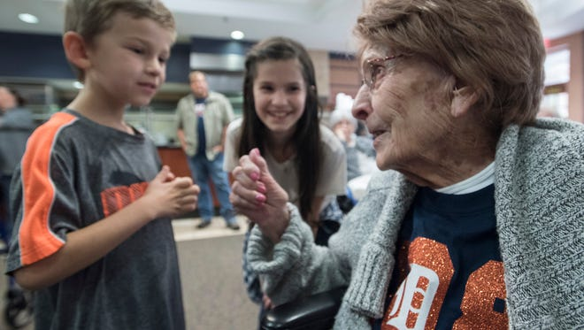 Regina Varrero speaks with great grandchildren Brody Melton, who is 100 years younger than Great-Grandma, and Kalea Melton, 12 years old.