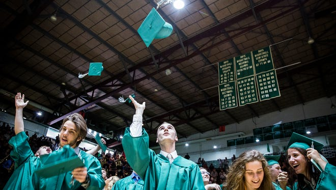 New Castle seniors receive their diplomas during their 2018 graduation ceremony at the New Castle Fieldhouse Sunday afternoon.