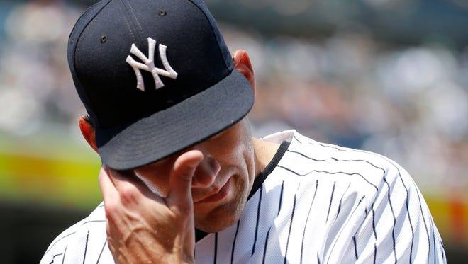 New York Yankees starting pitcher Nathan Eovaldi comes off the mound during the third inning of a baseball game after allowing a solo home run to Minnesota Twins' Danny Santana in New York, Sunday, June 26, 2016.