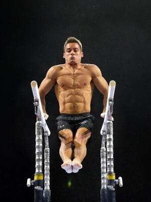 Sam Mikulak of the United States trains on the parallel bars during a practice session for the Pacific Rim Gymnastics Championships at Xfinity Arena on April 7, 2016 in Everett, Washington.