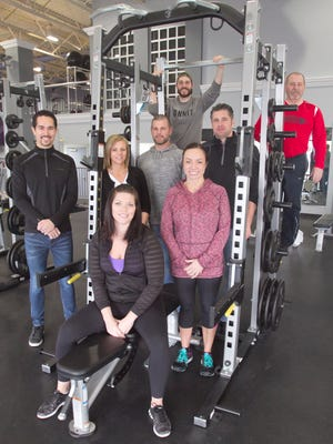 The staff of 2 Studio Gym in Genoa Township are ready to work with you. Seated in front is Jenna Pelfrey; from left, second row, Nick Haskamp, co-owners Sarah Powers, her husband Jason Powers, and spouses Heather and Rob McAllister; back row, from left, trainers Russ Klimczak and Ross Arnold. Not pictured is Jan Sredzinski.