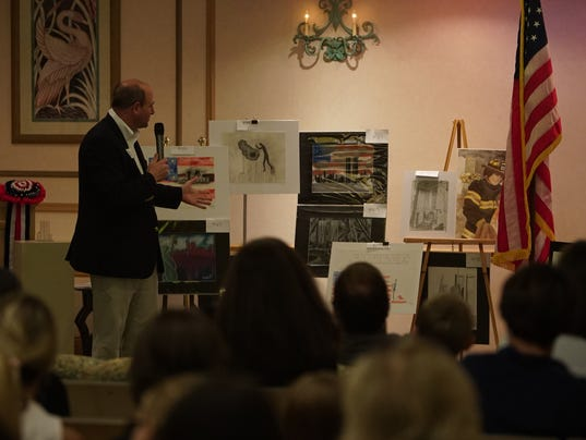 636426626843405976-Stuart-Mayor-Troy-McDonald-speaks-to-100-plus-guests-attending-the-2017-Never-Forget-Tribute-Youth-Art-Exhibition-Contest-Award-Ceremony.JPG