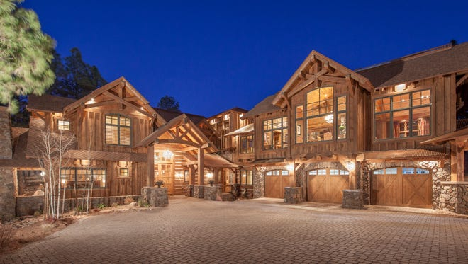 A log-cabin mansion with more than 12,000 square feet of space has sold for $4.1 million.