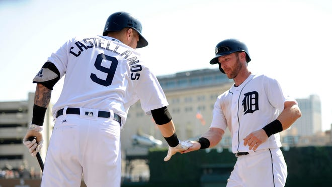 Detroit Tigers' Andrew Romine, right, is congratulated by Nicholas Castellanos (9) after scoring a run on a wild pitch during the fifth inning of a baseball game against the Minnesota Twins, Sunday, Sept. 24, 2017, in Detroit.