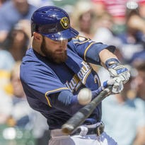 Milwaukee Brewers' Jonathan Lucroy connects for a sacrifice fly to right off Cincinnati Reds' Brandon Finnegan Sunday in Milwaukee.