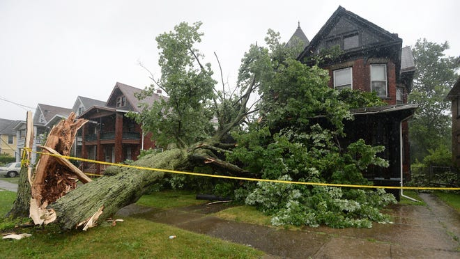 A fallen tree damaged this home in the 500 block of East Sixth Street on Saturday in Erie. Strong summer storms moving through Erie County led to numerous reports of trees down, roadways flooded and at least two boating rescues.
