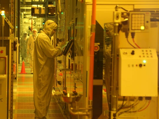 Technician inside GlobalFoundries' Fab 10 in East Fishkill