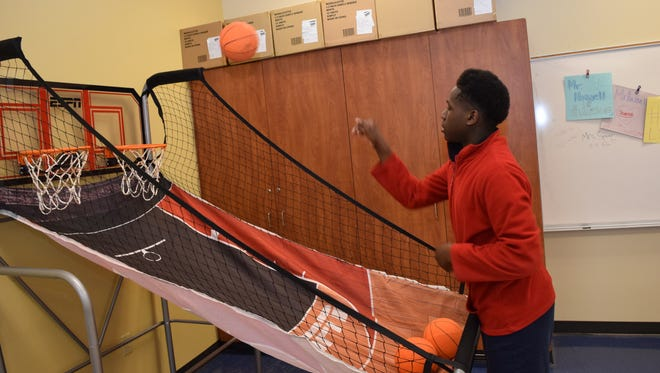 """J.I. Barron Elementary School student Keondrick Jones plays in the Barron Student Union. Students can purchase play time with """"Barron bucks"""" they receive for good behavior. The school has two student unions, one for older children and one for younger students."""