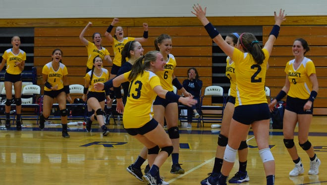 Ramsey volleyball players react to their first-set win versus Northern Highlands on Friday, Sept. 8, 2017. The Rams prevailed, 25-19, 25-23.