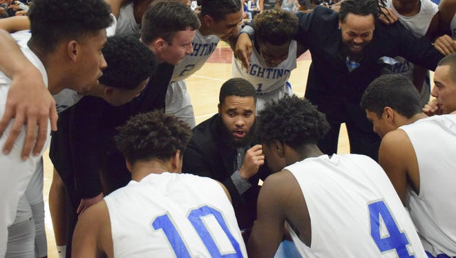 Robert E. Lee assistant boys basketball coach Terrell Mickens talks to his players before their season-opening game against Wilson Memorial on Friday, Dec. 15, 2017, at Paul Hatcher Gym in Staunton, Va. The defending state champions rolled over the Green Hornets 84-49 in their season opener.