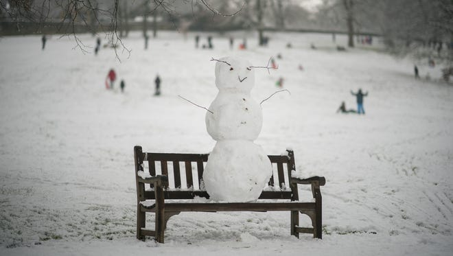 A snowman takes in the wintry view from a bench in Shibden Hall Park on Dec. 29, 2017 in Halifax, England.