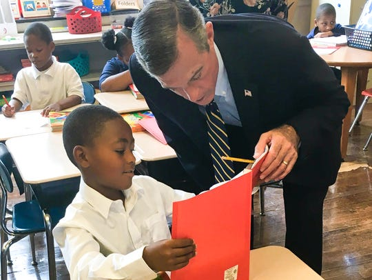 Gov. John Carney chats with a student during his visit
