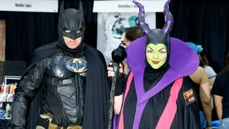 """Allen and Marci H. dress as Batman and Maleficent at Keen Halloween event at the Phoenix Convention Center Saturday, Sept. 24, 2016 in Phoenix. Marci actually got her face painted at Keen, and loves it because """"I haven't dressed up since June,"""" she said."""