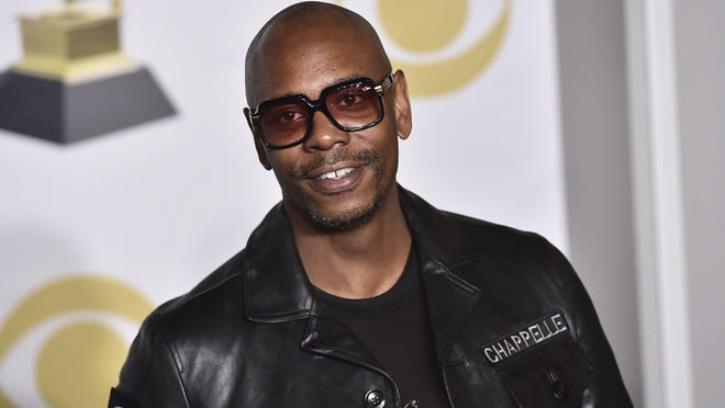"""In this Jan. 28, 2018, file photo, Dave Chappelle poses in the press room with the best comedy album award for """"The Age of Spin"""" and """"Deep in the Heart of Texas"""" at the 60th annual Grammy Awards in New York."""