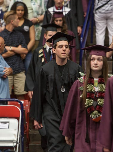 Graduates from Pine View High School celebrate their