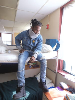 Jihad Snead sits on his bunk, number 5, in a wing of the Jersey Shore Rescue Mission for drug treatment in February 2015. Advocates and volunteers will be conducted a statewide count of all homeless people, in shelters or on the streets, on Wednesday.