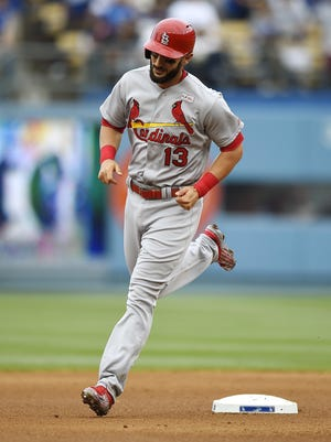 The Cardinals' Matt Carpenter rounds second after hitting a solo home run during the third inning on Sunday night.