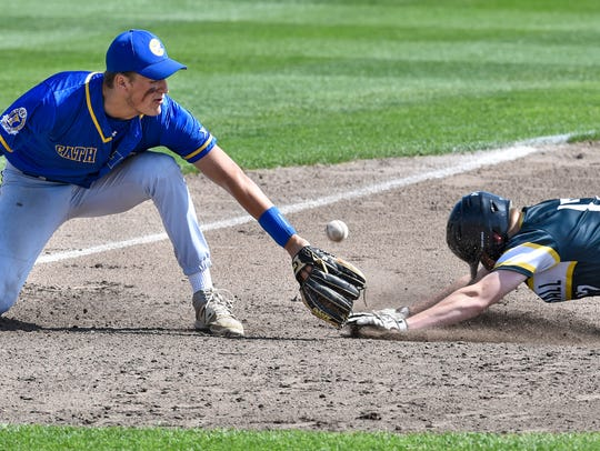 Cathedral third baseman Tyler Bautch tries to tag Duluth