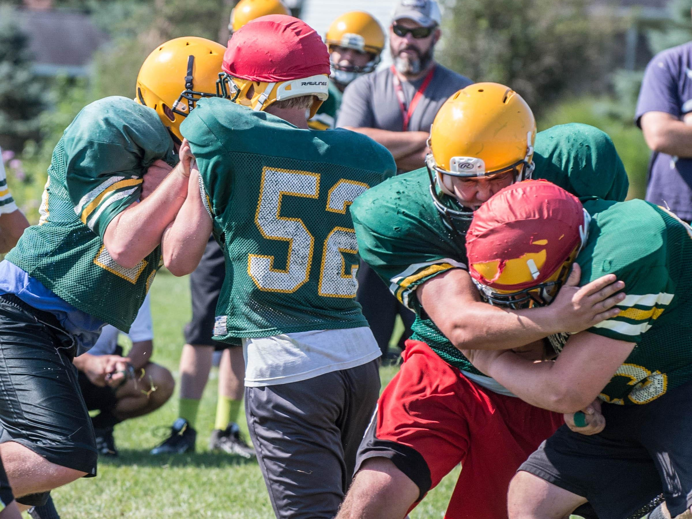 First day of practice with full pads for Pennfield High School football team.