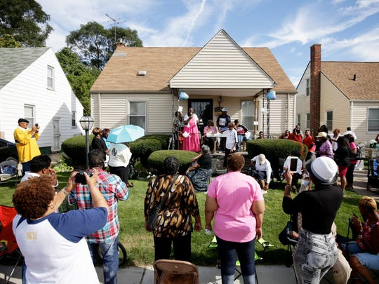 Valda Starr Hardaway thanks her neighbors, friends and family for attending the benefit concert in honor of her, in front of her house on Sunday, September 20, 2015, in Detroit. Choirs from throughout metro Detroit, celebrate and sing for Hardaway who served as a church choir director for over 20 years and is seriously ill with cancer.
