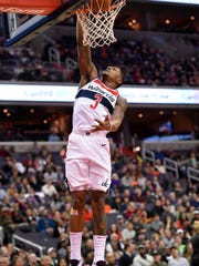 Wizards guard Bradley Beal dunks during the first half against the Hawks on Saturday.