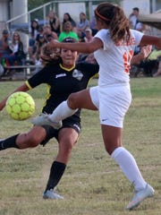 Alamogordo's Sydney Dorchester, left, puts the pressure on Artesia's Jannell Soto.