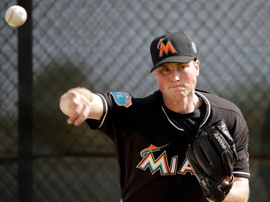 FILE - In this Feb. 22, 2016, file photo, Miami Marlins pitcher Carter Capps throws a bullpen session during spring training baseball practice in Jupiter, Fla. Miami Marlins reliever Carter Capps has a torn ligament in his throwing elbow that requires Tommy John surgery and will sideline him for the entire season. Miami announced the diagnosis Tuesday, March 8, 2016,  and the operation was to be performed later in the day by specialist Dr. James Andrews in Gulf Breeze, Florida. (AP Photo/Jeff Roberson, File)