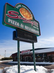 The large sign at Sammy's Pizza & Restaurant flashed