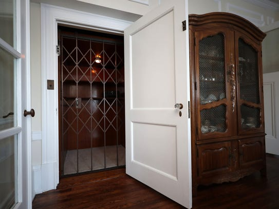 An elevator off of the dining room in this home on