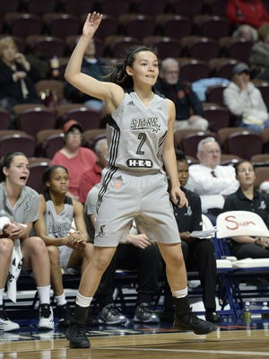 In this May 4, 2016 photo, San Antonio Stars' Kelsey Minato, gestures for a pass, during the second half of a WNBA basketball game against the Atlanta Dream, in Uncasville, Conn. Minato dreamed of playing in the WNBA growing up. She never thought that would become a reality when she decided to enroll at West Point four years ago. (AP Photo/Jessica Hill)