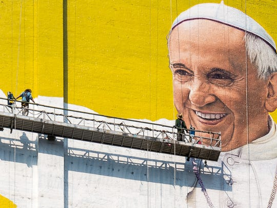 "Painters finish work on the ""Welcome Pope Francis"" mural in New York City on Aug. 31, 2015."