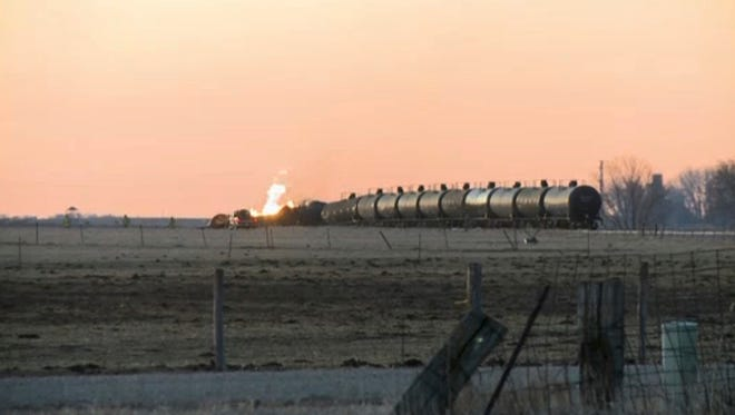 In this photo made from a video shot and provided by KTIV, several tank cars burn after a freight train carrying ethanol derailed around 1 a.m., Friday, March 10, 2017, near the small community of Graettinger in northwestern Iowa.