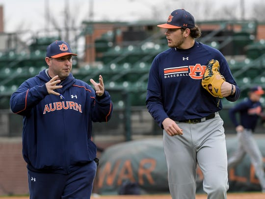 Auburn head coach Butch Thompson talking to pitchers during baseball practice on Friday, Jan. 27, 2017 in Auburn, Ala.