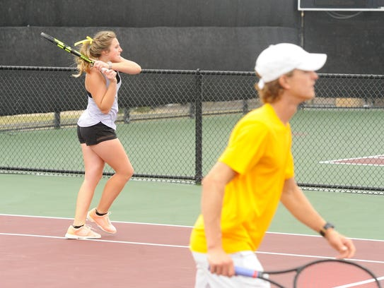 Wylie's Andrea McMillan hits a shot behind mixed doubles