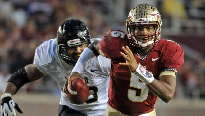 Florida State quarterback Jameis Winston (5) runs away from pressure by Idaho defensive end Maxx Forde (40) during the second half Nov. 23 at Doak Campbell Stadium.