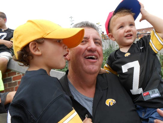 Dan Pyle, middle, with his grandsons Gabe Berger, left,