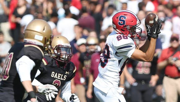 Stepinac's Brandon Gasparre (88) catches a pass over