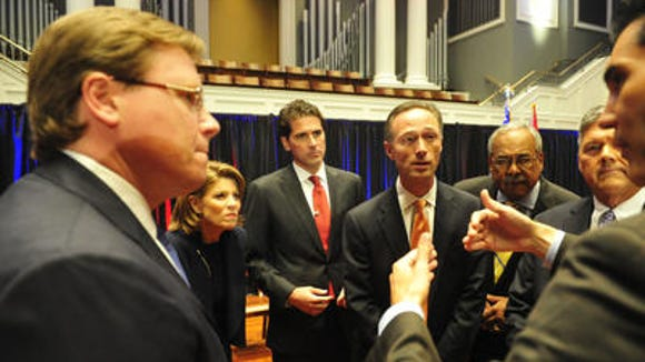 Mayoral candidate listen to the Tennessean's David Plazas prior to the second NashForward debate.
