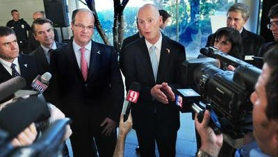 Frederico Fleury Curado, chief executive officer of Embraer jets (left) and Florida Gov. Rick Scott, are scheduled to be in Titusville Wednesday morning for the groundbreaking of Embraer Aero Seating Technologies. Here, the two men were announcing an Embraer expansion at Melbourne International Airport in 2013.