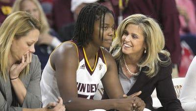 ASU women's basketball coach Charli Turner Thorne, right, won her 400th career game Monday at Hartford.