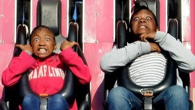 Shaterick Williams, left, and Emily Williams react to the Drop Zone ride at the State Fair of Louisiana.