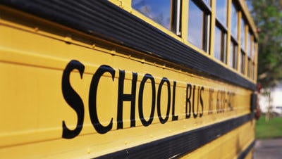 A school bus driver from New Brunswick has been charged with leaving an autistic 9-year-old boy unattended on a school bus for four hours.
