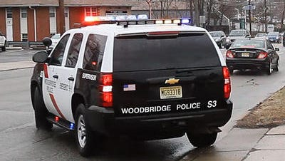 A Woodbridge police officer was injured Tuesday when his  gun discharged as it was being unloaded at the department's shooting range.