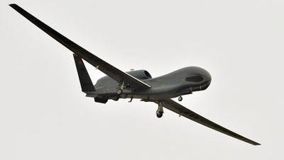 A U.S. Global Hawk surveillance drone prepares to land at the Misawa Air Base in Misawa, northern Japan, Saturday, May 24, 2014.