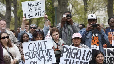 Low-wage workers rally on Capitol Hill in Washington, Monday, April 28, 2014, to urge Congress to raise the minimum wage