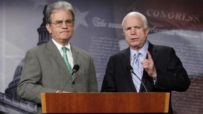 Sen. Tom Coburn, R-Okla., left, is Sen. John McCain's choice to replace Eric Shinseki as secretary of Veterans Affairs. But Coburn doesn't appear interested in the job.