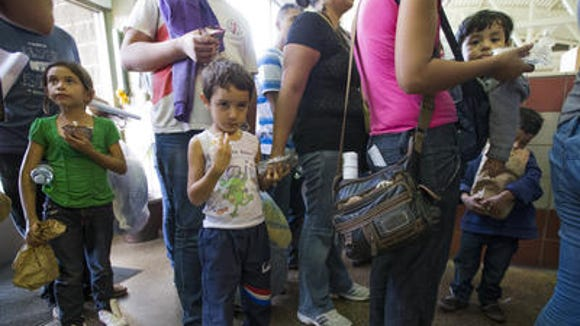 Central Americans dropped at bus station in Phoenix.