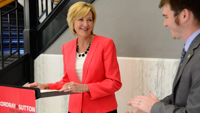 Democratic lieutenant governor candidate Betty Sutton is applauded by Sandusky County Democratic Party Chairman Chris Liebold during a campaign stop at the Sandusky County Courthouse Thursday.